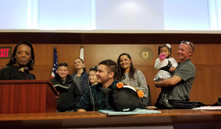 Genevieve Traversy's family adopts their new daughter in a courtroom.