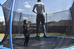 Client jumping on new trampoline